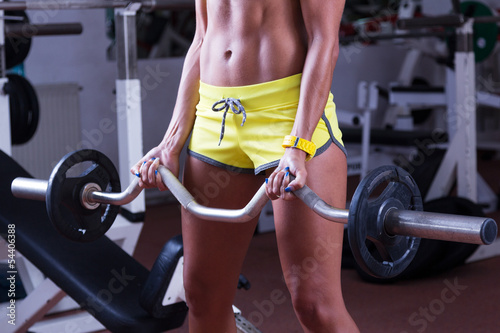 canvas print picture Girl lifting weights at gym