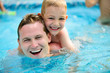 Young father and little son swimming in pool - 54408313