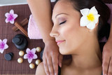 attractive woman getting spa treatment with massage stones