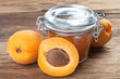 Lot of apricot with a glas of marmelade