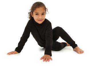 Beautiful Hispanic Preschooler barefoot on white floor with clip