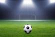 Soccer ball, goal, spotlight