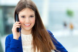 Smiling businesswoman talking at the phone