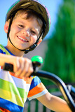 Fototapety Cute little boy riding bicycle