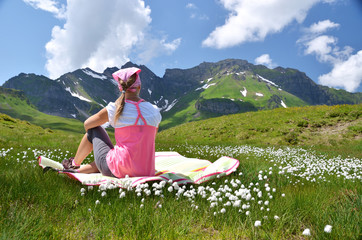Girl in an Alpine meadow. Melchsee-Frutt, Switzerland