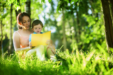 Mother reading book for child