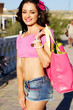 Pretty woman with the pink beach bag