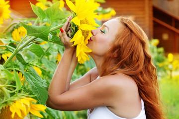 Photo of pretty girl among sunflowers