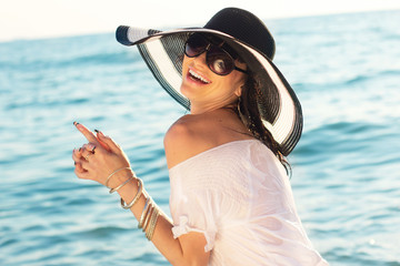 Beautiful girl on beach in fashion hat