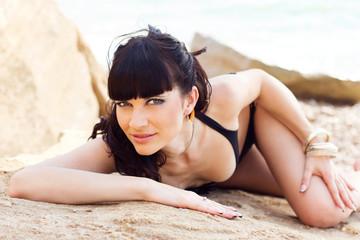 Beautiful girl on beach in fashion hat