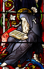 Reading monk in stained glass