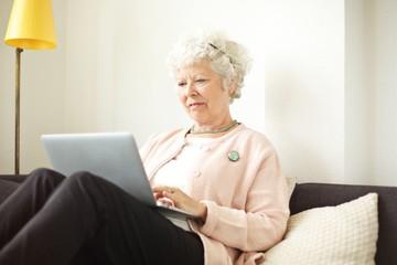 Retired Senior Woman Working on Her Laptop