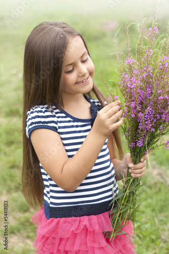 beautiful little girl with wildflowers