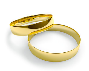 Two golden wedding rings isolated on white