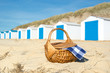 Picnic at beach with Blue huts - 54418724