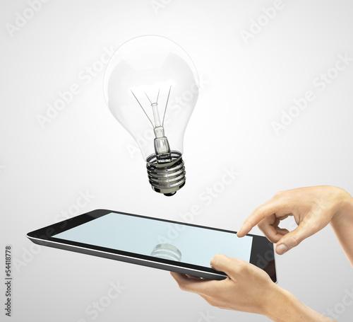tablet and lightbulb