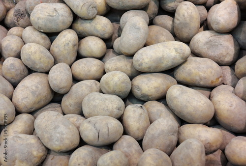 potatoes in market as background