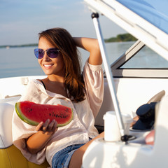 Attractive young girl on a yacht