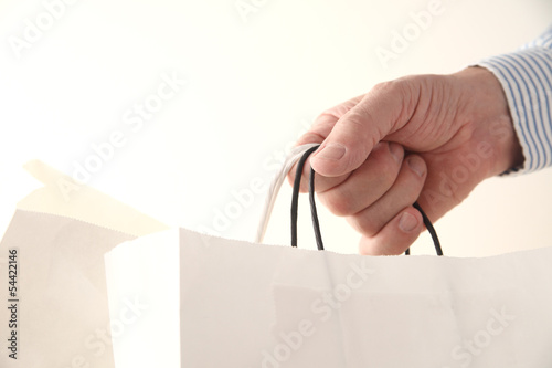 man holds shopping bags