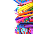 Vertical border of colorful school supplies over white