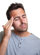 Latin man with a headache