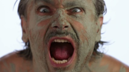 fierce facial expressions and grimaces of a primitive man