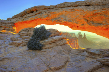 sun rising over mesa arch, arches national park, utah