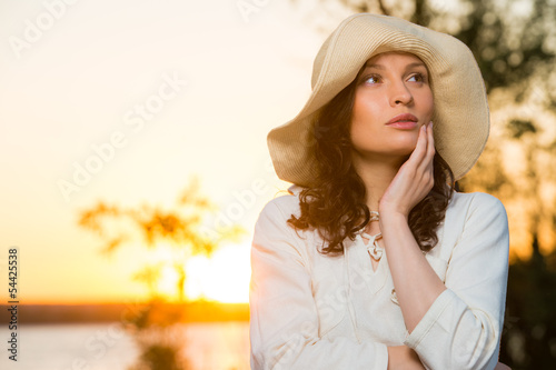 Romantic girl on the beach during sunset