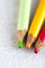 three coloured pencil