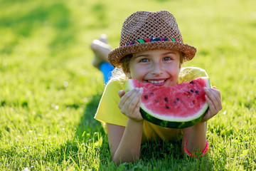 Summer joy - happy girl eating fresh watermelon
