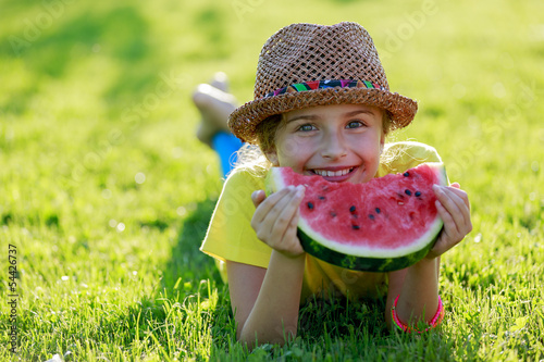 Tuinposter Picknick Summer joy - happy girl eating fresh watermelon
