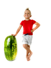 punk little boy  with a giant watermelon