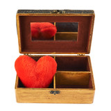 Plush heart in a wooden casket