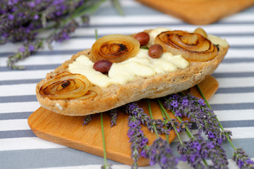 Ciabatta bread with mozzarella, olives and onion