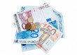 Isolated euro banknotes and coins