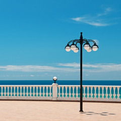 beautiful promenade with lanterns and white railings