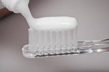 toothbrush and toothpaste from tube