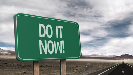 Amazing sign on the road with the message - Do It Now!