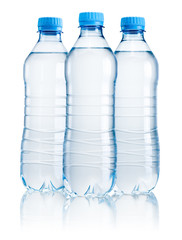 Three plastic bottle of drinking water isolated on white backgro
