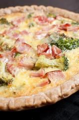 Closeup quiche with ham, bacon and broccoli