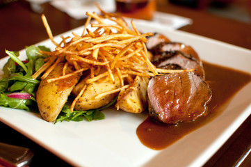 Gourmet beef frites with potatoes
