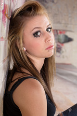Serious Girl at Wall