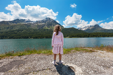 portrait of girl on the shore of a mountain lake