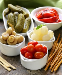 pickled snacks (tapas) - mushrooms, tomatoes, cucumbers