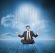 Businessman meditating and smiling