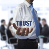 Smart businessman holding the word trust
