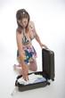 Woman sorting her cabin bag packing