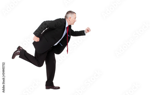 Businessman running isolated on white