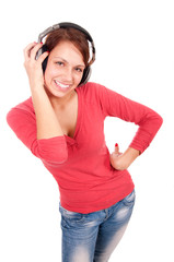 Happy young woman with headphones isolated over a white backgrou