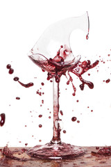 Broken wine glass with splashing wine